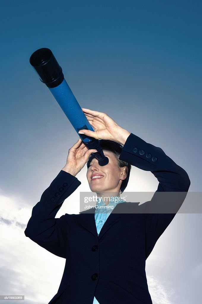 Businesswoman Looking Through a Telescope : Stock Photo