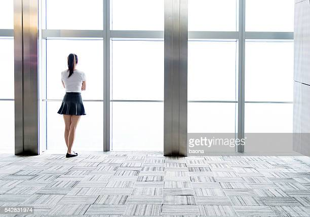 Businesswoman looking through the window