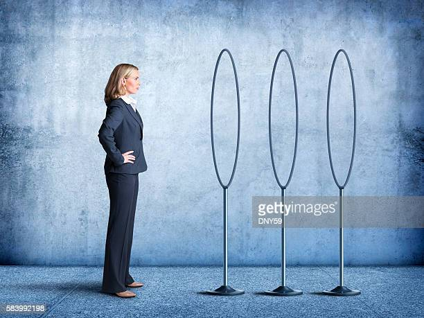 Businesswoman Looks At Multiple Hoops She Must  Jump Through