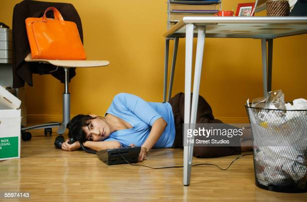 businesswoman lying down on floor - collapsing stock pictures, royalty-free photos & images