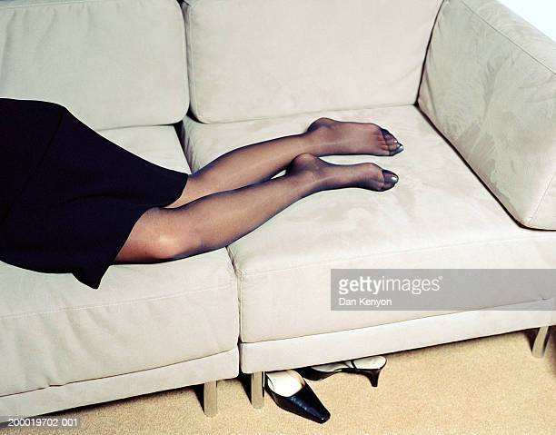 businesswoman lying on sofa, shoes on floor, low section - pantyhose ストックフォトと画像
