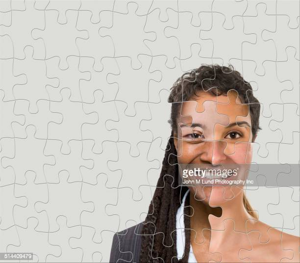 businesswoman made of puzzle pieces - prejudice stock photos and pictures