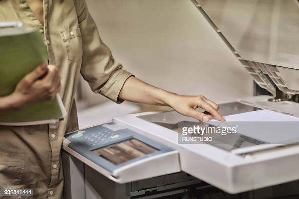 Businesswoman making a copy in office