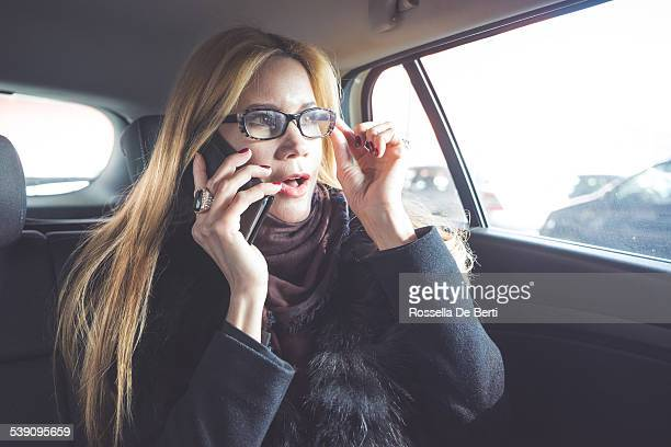Businesswoman Making Call With Smartphone