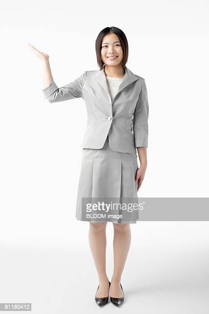 Businesswoman making pose, portrait, studio shot