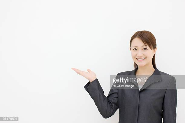 Businesswoman making pose, studio shot, portrait