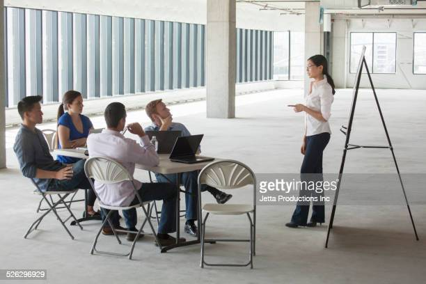 Businesswoman making presentation in meeting