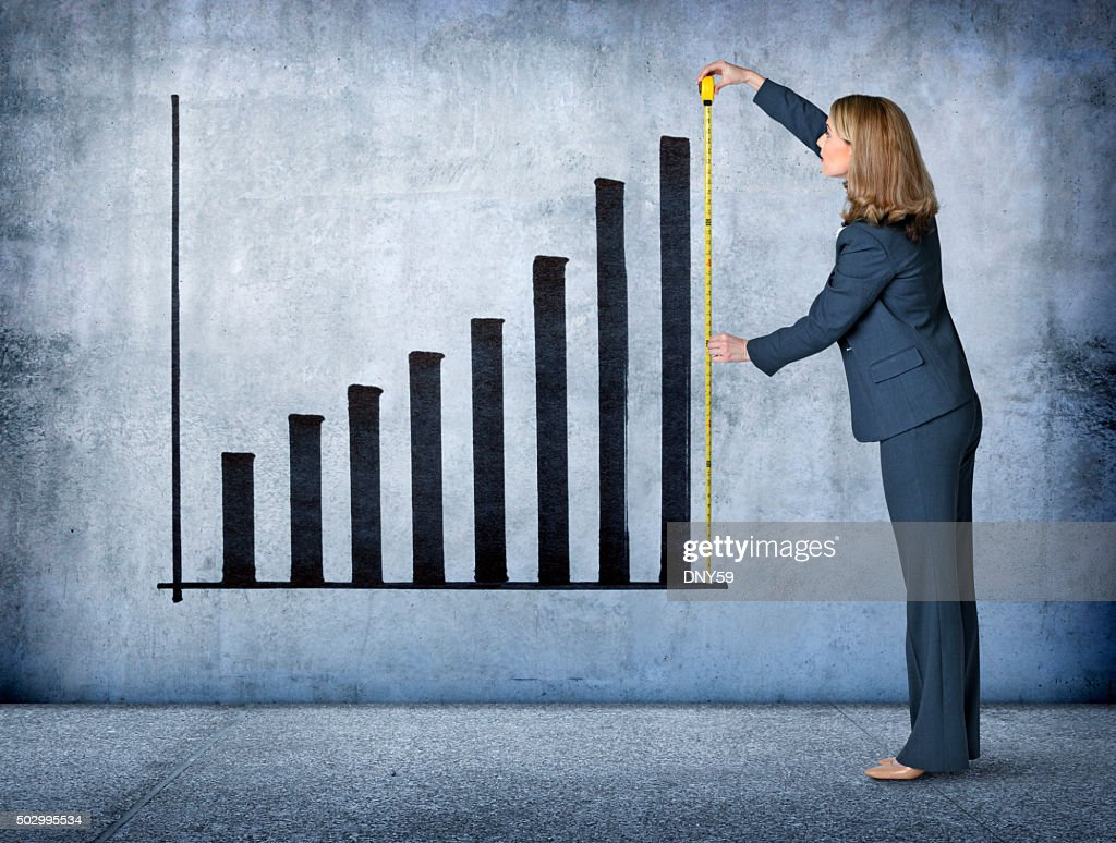 Businesswoman Measures Growth With Tape Measure : Stock Photo
