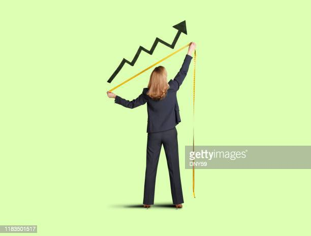 businesswoman measuring progress - instrument of measurement stock pictures, royalty-free photos & images