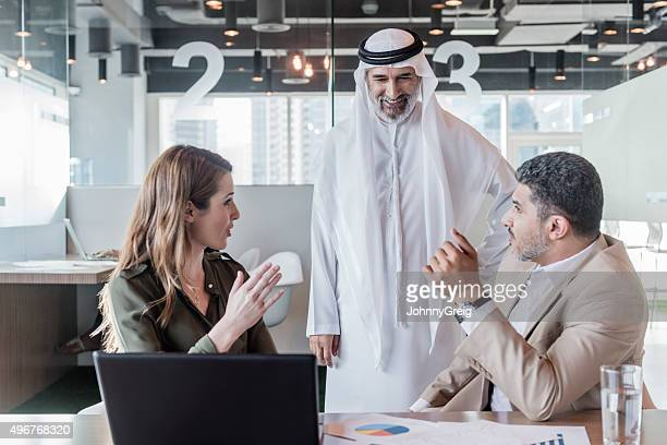 Businesswoman meeting with Arab businessmen, Dubai, UAE