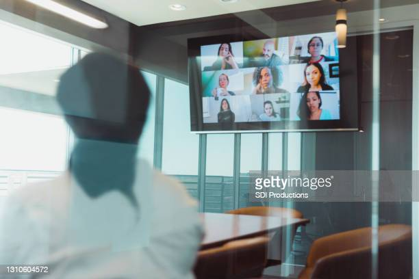 businesswoman meets with colleagues virtually - brainstorming stock pictures, royalty-free photos & images