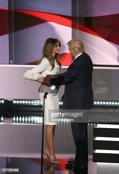 Businesswoman Melania Trump and republican presidential candidate Donald Trump embrace on stage during the Republican National Convention at Quicken...