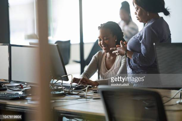 businesswoman mentoring her staff - successor stock pictures, royalty-free photos & images