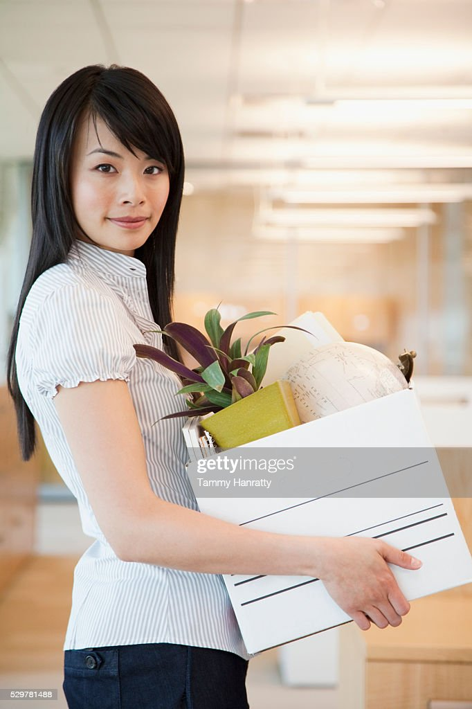 Businesswoman moving in office : Stock Photo