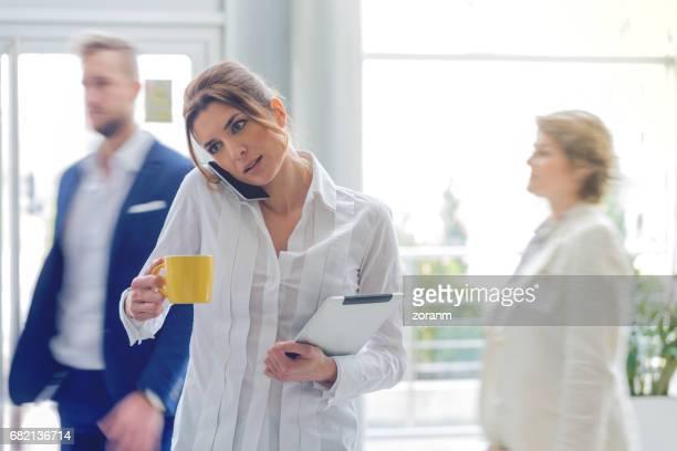 Businesswoman multi-tasking