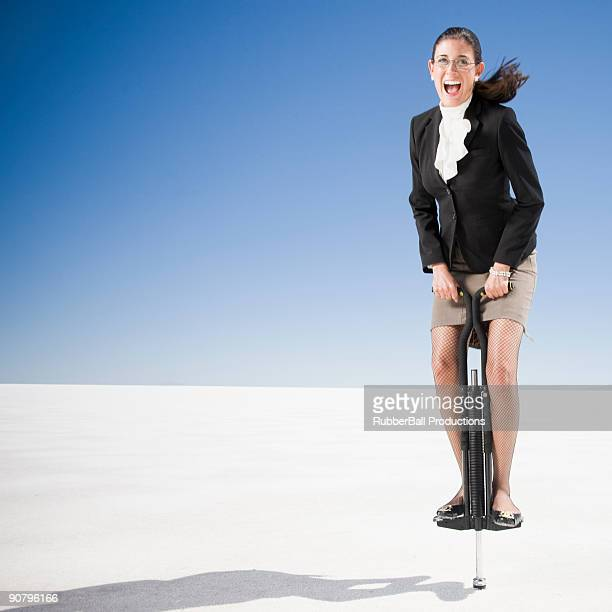 businesswoman on a pogo stick