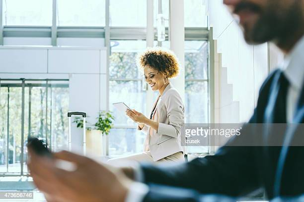 Businesswoman on business travel using digital tablet in hotel