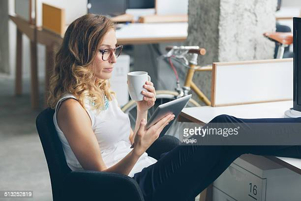 businesswoman on coffee break in office. - coffee break stock pictures, royalty-free photos & images