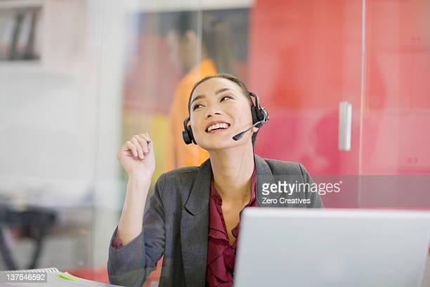 Businesswoman on headset at desk
