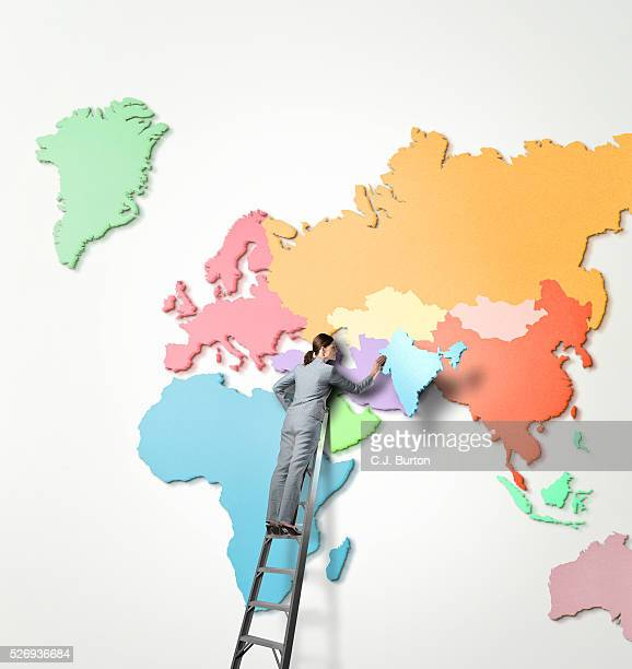 businesswoman on ladder holding map of india - south asia stock pictures, royalty-free photos & images