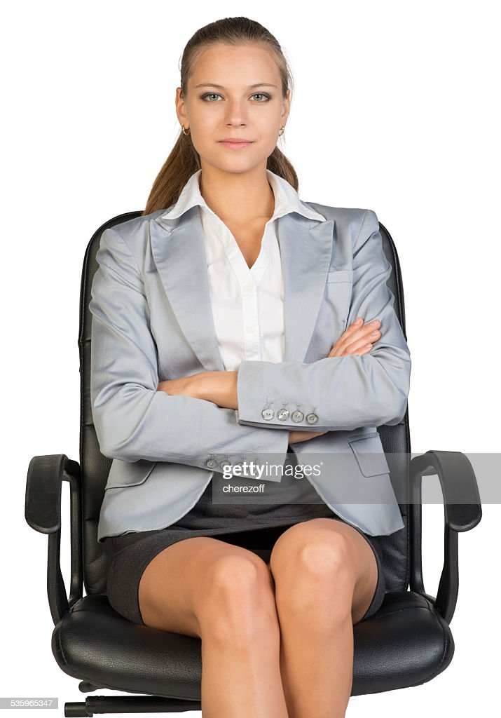 Businesswoman on office chair : Stock Photo