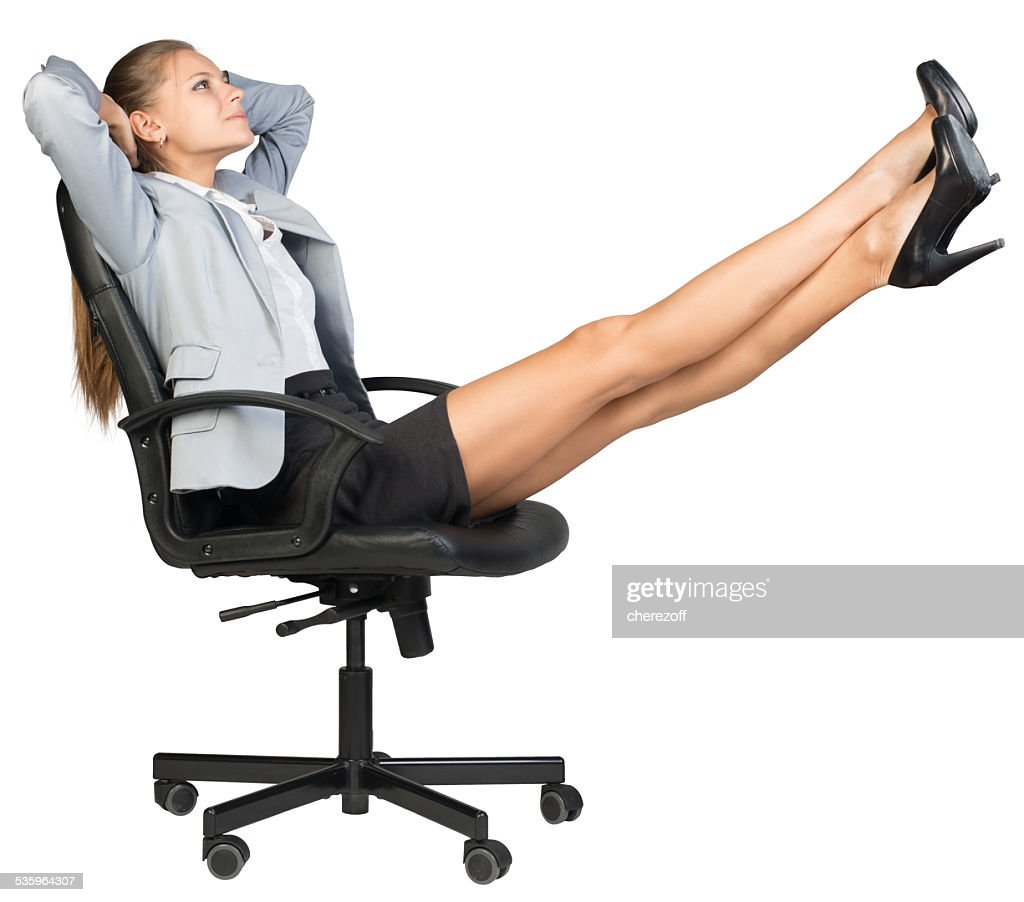 Businesswoman on office chair with her feet up : Stock Photo
