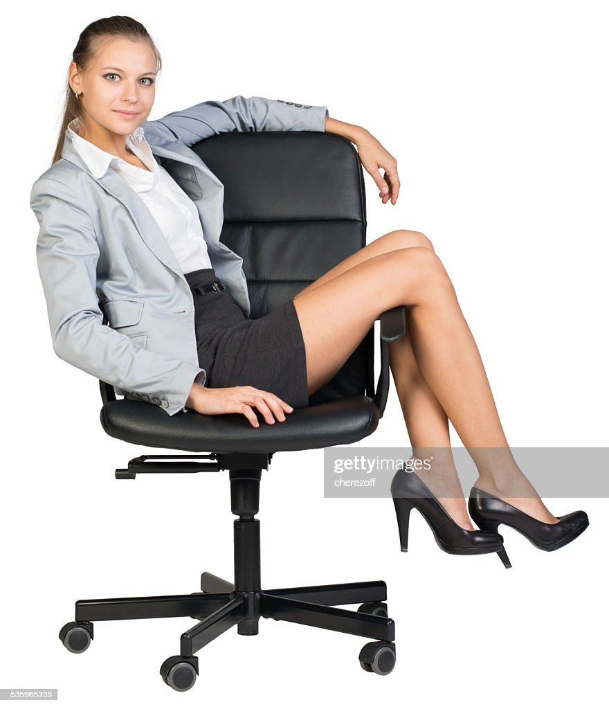 Businesswoman on office chair with her legs over armrest : Stock Photo