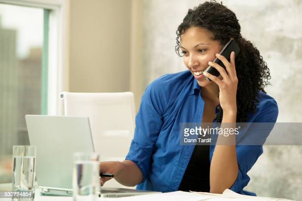 Businesswoman on Phone and Laptop