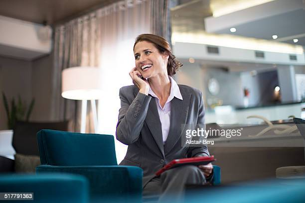 Businesswoman on phone in hotel