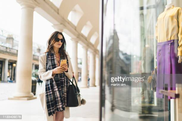 businesswoman on shopping - shop stock pictures, royalty-free photos & images