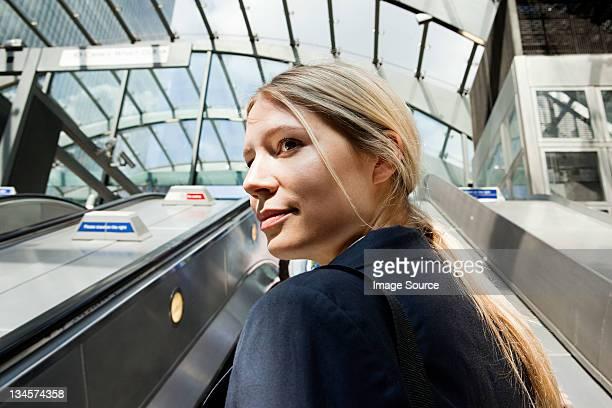 Businesswoman on subway escalators