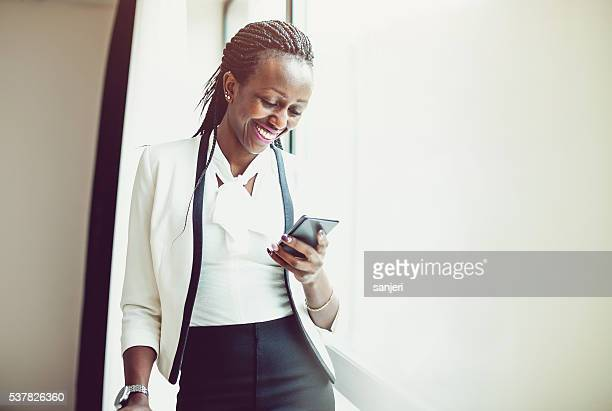 Businesswoman on the phone at the hotel room
