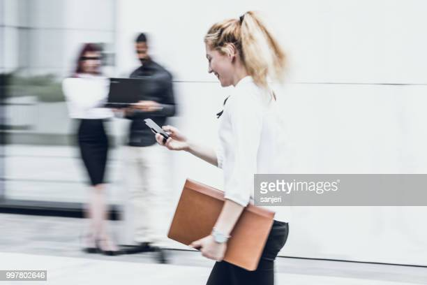 Businesswoman on The Phone, Blurred Motion