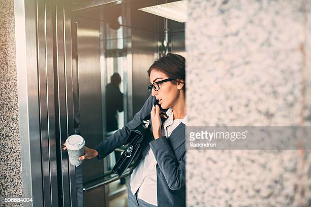Businesswoman On The Phone In The Elevator