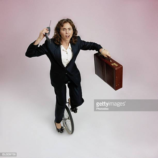 Businesswoman on Unicycle