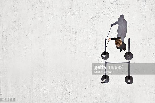 Businesswoman opening rope on cordon post