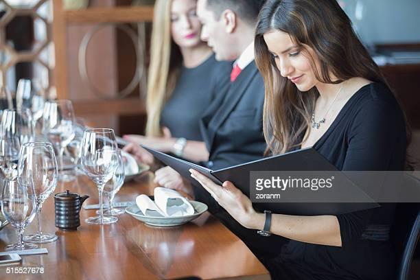 Businesswoman ordering meal in restaurant