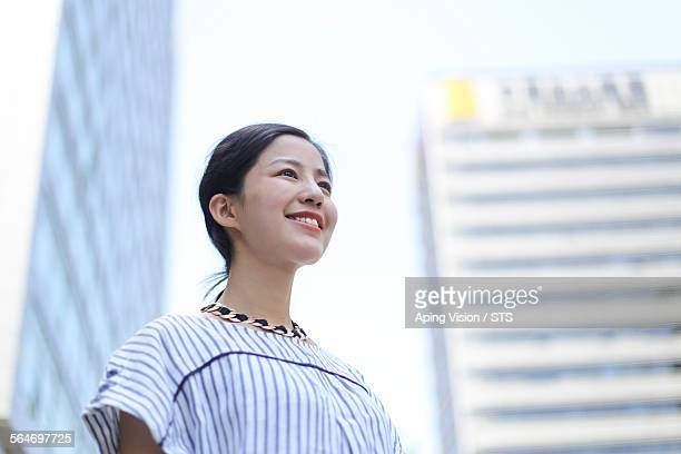 businesswoman outdoor close to office building