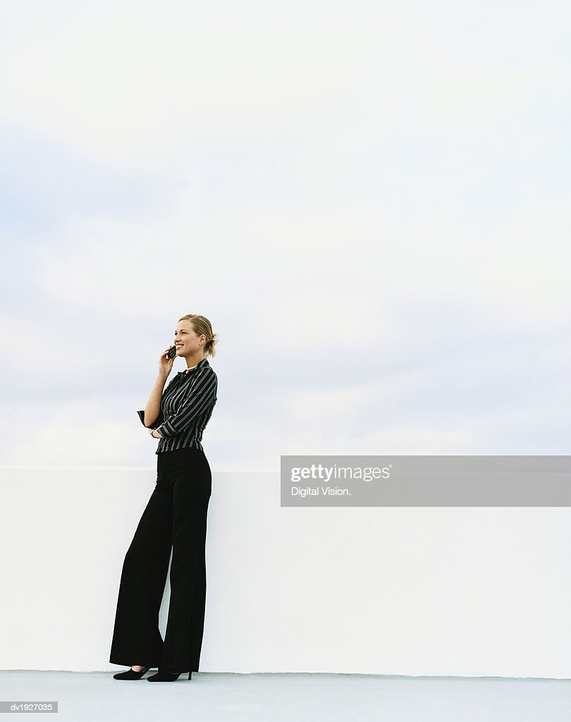 Businesswoman Outdoors Using Her Mobile Phone : Stock Photo