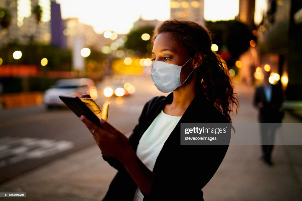 Businesswoman outdoors wearing healthcare mask. : Stock Photo