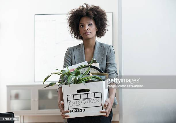 businesswoman packing up box in office - downsizing unemployment stock pictures, royalty-free photos & images