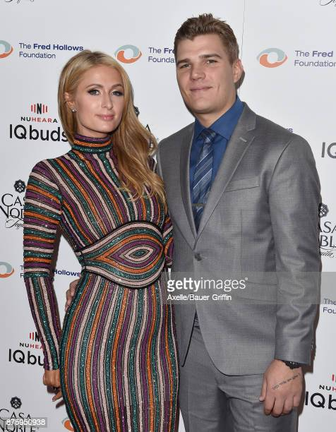 Businesswoman Paris Hilton and Actor Chris Zylka arrive at the inaugural Los Angeles gala dinner in support of The Fred Hollows Foundation at DREAM...