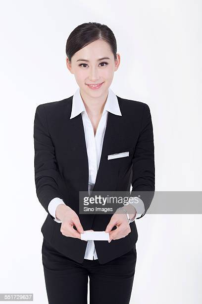 Businesswoman Passing a Business Card