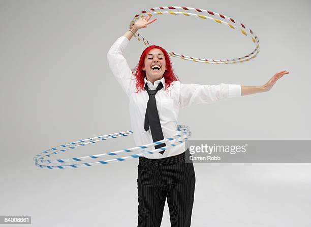 Businesswoman performing with Hoola Hoops