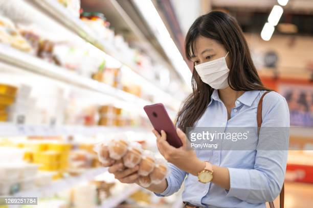 businesswoman picks up eggs - medical scan stock pictures, royalty-free photos & images