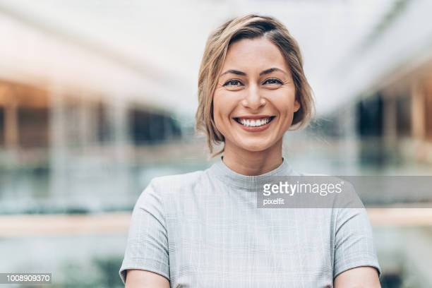 businesswoman - smiling stock pictures, royalty-free photos & images