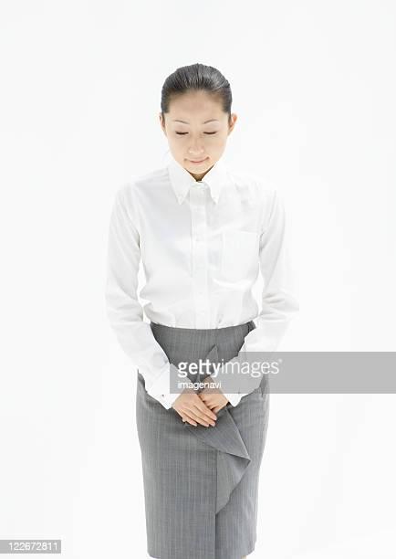 businesswoman - お辞儀 ストックフォトと画像