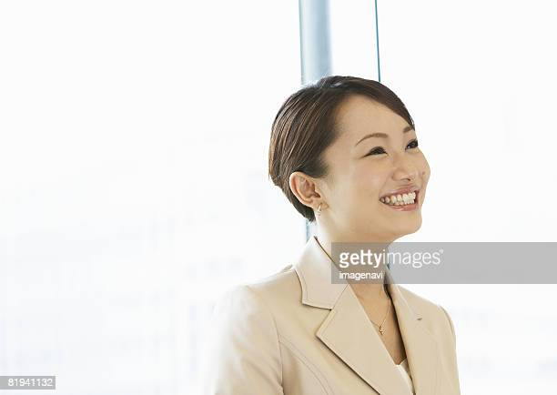 businesswoman - beige suit stock pictures, royalty-free photos & images