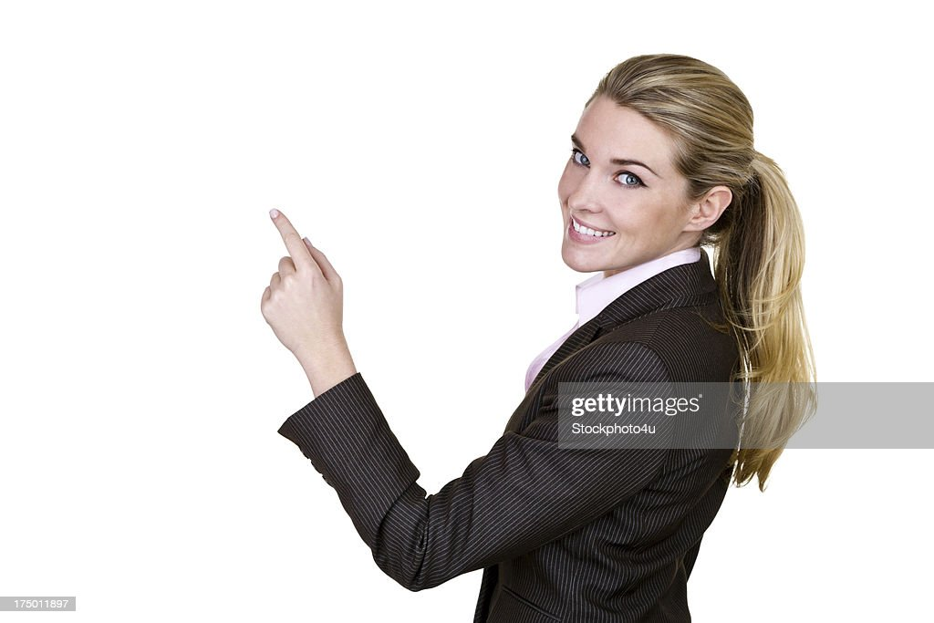 Businesswoman pointing to copy space : Stock Photo
