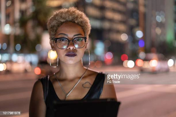 Businesswoman Portrait at night using tablet
